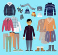 Boy in Warm Clothes Stands in Centre on Blue. Royalty Free Stock Photo