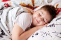 Boy was asleep on pillow with Chinese characters Royalty Free Stock Photo