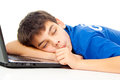Boy was tired and fell asleep on a laptop Royalty Free Stock Image