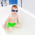 Boy washing in bath wearing glasses for swimming little the Stock Image
