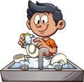 Boy washing dishes Royalty Free Stock Photo