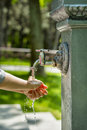 Boy washing hands outside Royalty Free Stock Photo