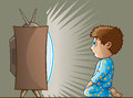 Boy watching tv cartoon of a transfixed by the Royalty Free Stock Photography