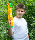Boy with water pistol a Royalty Free Stock Image