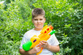 Boy with water pistol a Stock Photo