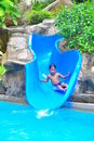 A boy on a water slide Stock Images