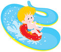 Boy on a water slide little slides down in waterpark Royalty Free Stock Photos