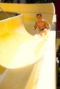 Boy on water slide Royalty Free Stock Photo