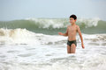 Boy in waves in ocean Royalty Free Stock Photo