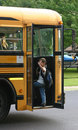 Boy Waving getting on Bus Royalty Free Stock Photography
