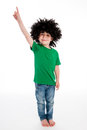 Boy wearing a big black wig pointing his finger in the air young studio on white background with funny Stock Photography