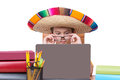 Boy Wearing Glasses and Sombrero and Using Laptop Royalty Free Stock Photo