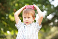 Boy wearing a knitted crown on the head Royalty Free Stock Photos