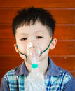 Boy wearing oxygen mask. Royalty Free Stock Photo