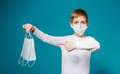 Boy wearing protection mask pointing on masks Royalty Free Stock Photo