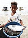 Boy Wearing White Crew-neck T-shirt Holding Blue Plastic Basin Full of Lobster and Fish