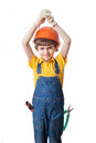 The boy wears hardhat and holds hands above head isolated on white Royalty Free Stock Photo