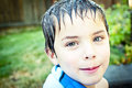Boy with wet hair smiling at the camera Royalty Free Stock Photo