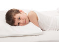 Boy in white bed lying on Royalty Free Stock Photo