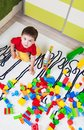 Boy who builds castles with cubes little plastic Stock Image