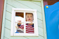 Boy who is looking out in a window of a children s four year old lodge Royalty Free Stock Photography