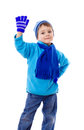 Boy in winter clothes with greeting sign Royalty Free Stock Photo