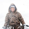 Boy winter portrait at snowfall Royalty Free Stock Photography