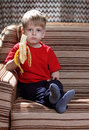 Boy wirh banana Stock Photos