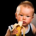 Boy wit banana Royalty Free Stock Image