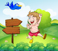 A boy beside a wooden arrow and the blue bird illustration of Stock Photo