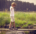 Boy on a wooden bridge Royalty Free Stock Photo