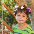 The boy wore a wreath of flowers cheerful birthday beautiful in park Royalty Free Stock Photography