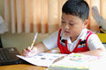 The boy work homework carefully Royalty Free Stock Images
