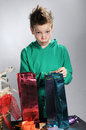Boy wrapping gifts portrait of a christmas Royalty Free Stock Photos