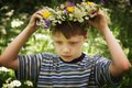 Boy and wreath of flowers Royalty Free Stock Images