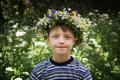 Boy and wreath of flowers Stock Image