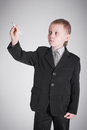 Boy writes in a black suit writing pen Royalty Free Stock Photos