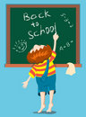 The boy writes on a blackboard. Royalty Free Stock Photography