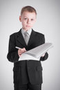 Boy writes in a business suit writing Stock Photos