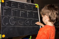 Boy writing letters learning process knowledge of small child Royalty Free Stock Photo