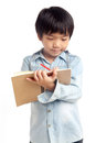 Boy writing with smile Royalty Free Stock Photo