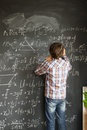 Boy writting on black board Royalty Free Stock Photo