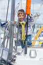 Boy in yacht club cute happy rests on and is glad at life Royalty Free Stock Image