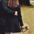 Boyfriend bonding his lovely girl autumn picture Royalty Free Stock Photos