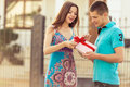 Boyfriend a gift girl men presented surprise to woman Royalty Free Stock Photos