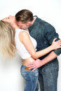 Boyfriend and girlfriend kissing portrait of a against white background Royalty Free Stock Images