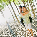 Boyfriend giving girlfriend piggy back ride Royalty Free Stock Photo