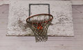 Boyhood dreams old basketball net on a worn basketball backboard Royalty Free Stock Photos