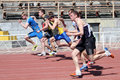 Boys on the 100 meters race Stock Photography