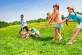 Boys against girls team of pulling the rope in dandelion Royalty Free Stock Photos